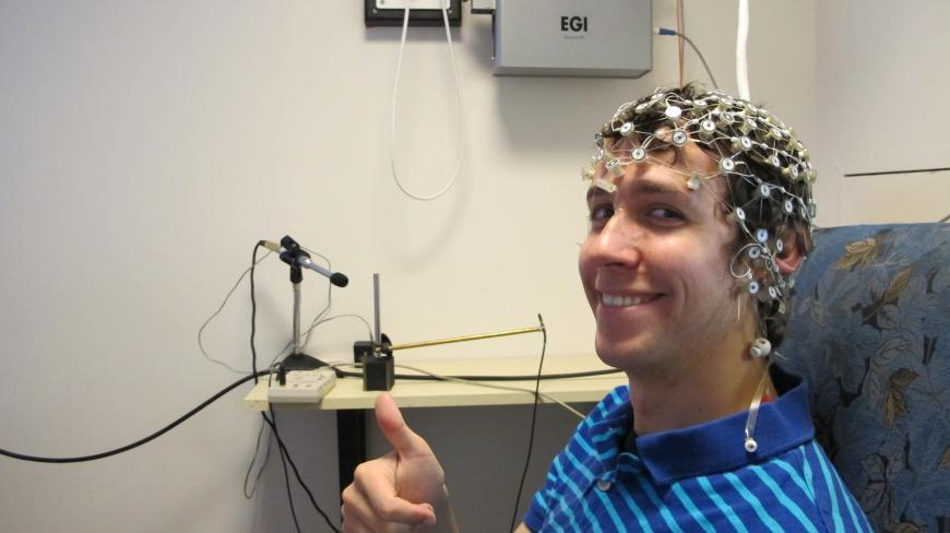 Elliot Layden wears an EEG net.